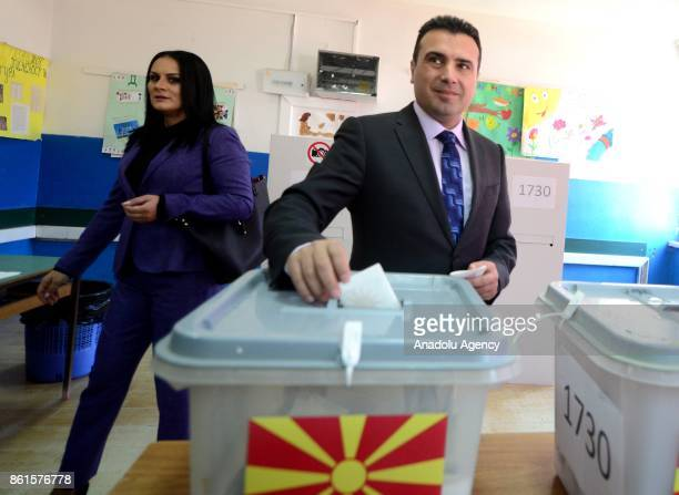 Macedonian Prime Minister Zoran Zaev accompanied by his wife Zorica Zaeva casts his ballot at a polling station during local election in Strumica...