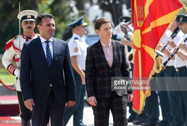 Macedonian Prime Minister Zoran Zaev inspects an honour guard with Prime Minister of Serbia Ana Brnabic during an official welcoming ceremony in...