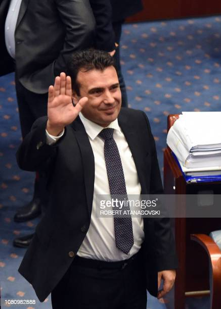 Macedonian Prime Minister Zoran Zaev waves to journalists after Macedonia's deputies voted to change the country's name to 'the Republic of North...