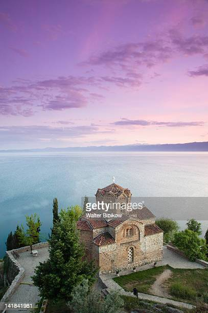 macedonia-ohrid: sveti jovan at kaneo church (13th century) and lake ohrid / dusk - lake ohrid stock photos and pictures
