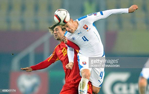 Macedonia's Besart Abdurahimi vies with Slovakia's Jan Durica during the UEFA Euro 2016 qualifying football match between Macedonia and Slovakia at...