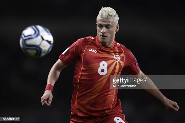 Macedonia's defender Ezgjan Alioski eyes the ball during the FIFA World Cup 2018 qualification football match between Italy and Macedonia on October...