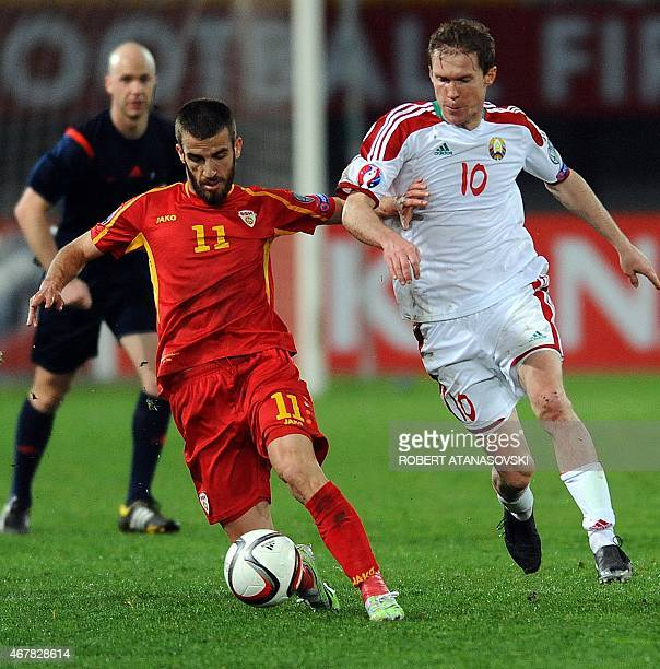 Macedonia's Ferhan Hasani challenges Belarus's Aleksandr Hleb during the Euro 2016 group D qualifying football match between Macedonia and Belarus at...