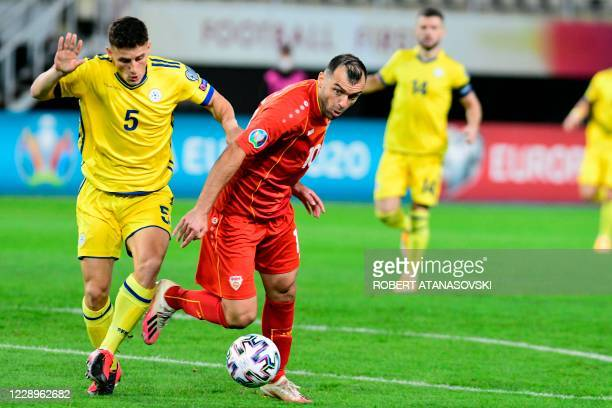 Macedonia's forward Goran Pandev fights for the ball with Kosovo's midfielder Herolind Shala during the UEFA Euro 2020 Playoff Semi-Final football...
