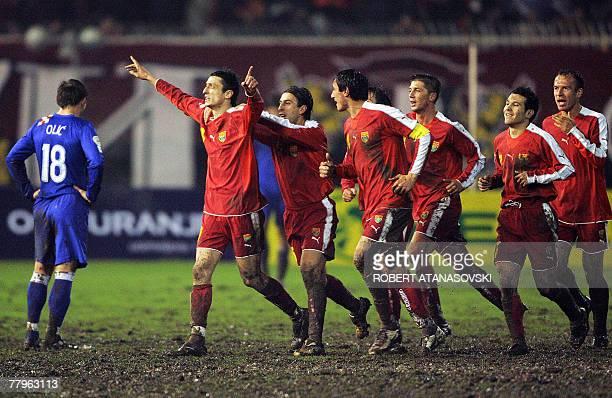 Macedonia's Goran Maznov celebrates with teammates after scoring the goal against Croatia during their group E Euro 2008 qualifying football match 17...