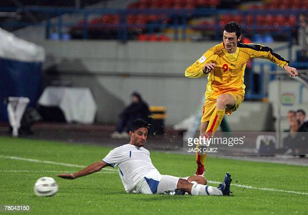 Macedonia's Goran Maznov vies for the ball with Israel's Barak Itzhaki during the Euro 2008 qualifying football match between Israel and Macedonia at...