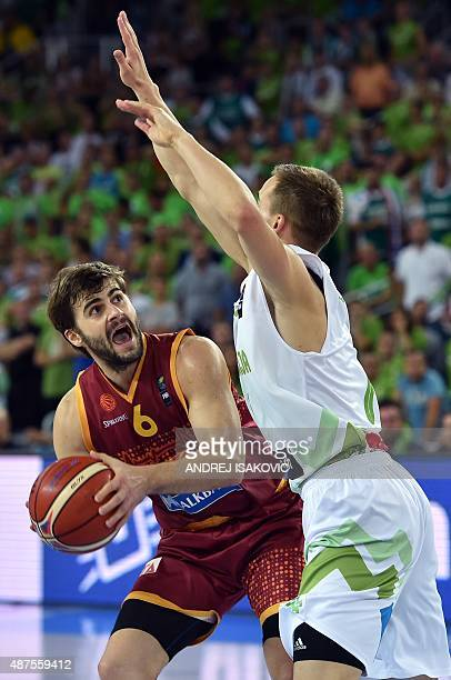 Macedonia's guard Darko Sokolov vies with Slovenia's guard Klemen Prepelic during the Group C qualification basketball match between Slovenia and...