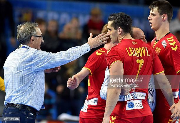 Macedonia's head coach Lino Cervar congratulates Macedonia's right back Kiril Lazarov after drawing in the 25th IHF Men's World Championship 2017...