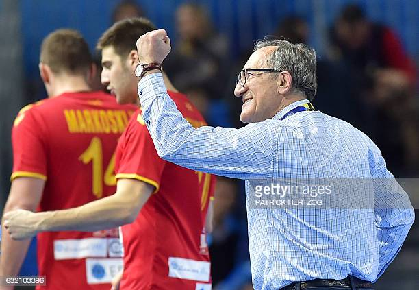Macedonia's head coach Lino Cervar raises the fist after drawing in the 25th IHF Men's World Championship 2017 Group B handball match Macedonia vs...