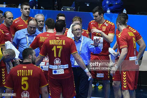Macedonia's head coach Lino Cervar talks to his players during the 25th IHF Men's World Championship 2017 eighth final handball match Norway vs...