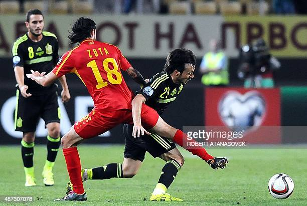 FYR Macedonia's Leonard Zhuta vies with Spain's David Silva during the Euro 2016 Group D qualifying football match between FYR Macedonia and Spain at...