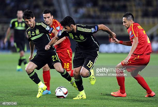 Macedonia's NIkola Gligorov and Vladica Brdarovski vie with Spain's Diego Costa and David Silva during the Euro 2016 qualifying football match...