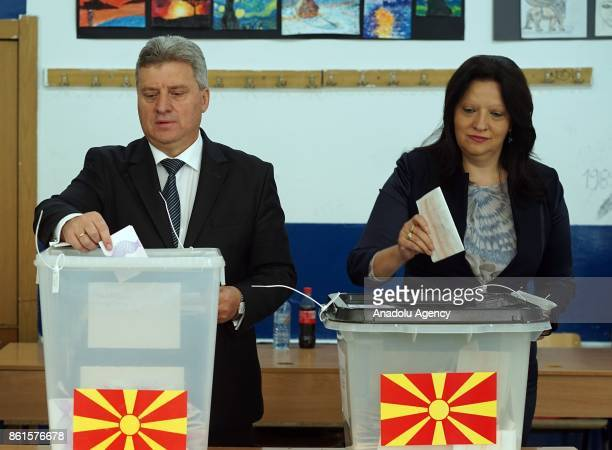 Macedonia's President Gjorge Ivanov and his wife Maja Ivanova cast their ballots at a polling station during local election in Skopje Macedonia on...