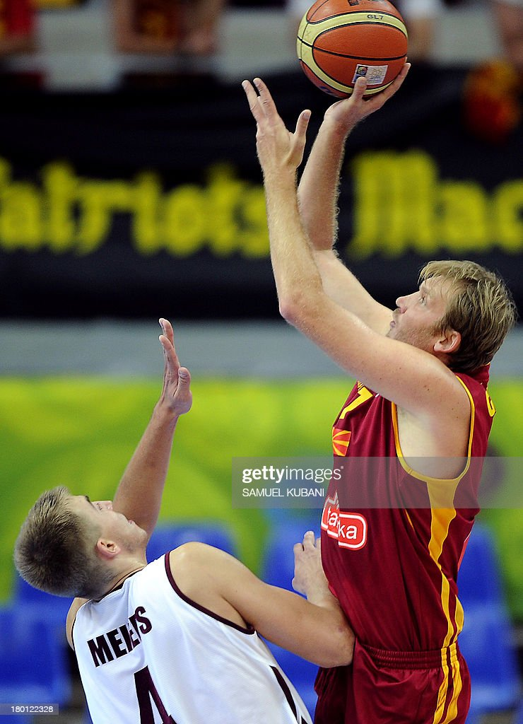 Macedonia's Todor Gechevski (R) challenges Latvia's Martins Meiers during the 2013 EuroBasket Championship group B match between F.Y.R. Macedonia and Latvia in Jesenice on September 9, 2013.