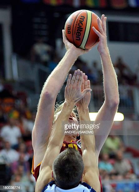 Macedonia's Todor Gechevski vies with Bosnia's Nemanja Gordic during the EuroBasket 2013 Group D match between Finland and Russia in Koper on...