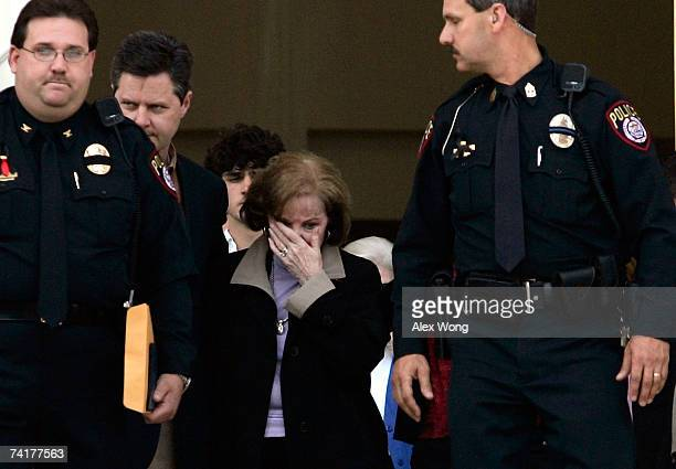 Macel Falwell leaves with her son Jerry Jr after a viewing of her late husband the Rev Jerry Falwell lying in repose at Arthur S DeMoss Learning...