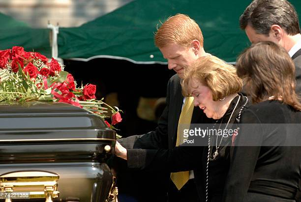 Macel Falwell touches the casket of her late husband Rev Jerry Falwell as her children Jonathan Jerry Jr and Jeannie Savas join her during burial...