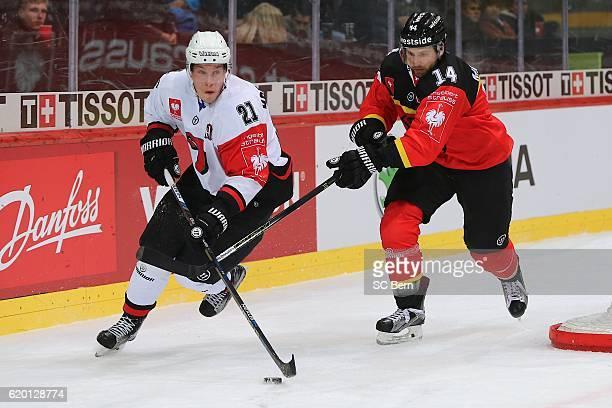 MACENAUEr Maxime of Bern challenges HOTAKAINEN Valtteri of Jyvaskyla during the Champions Hockey League Round of 16 match between SC Bern and JYP...