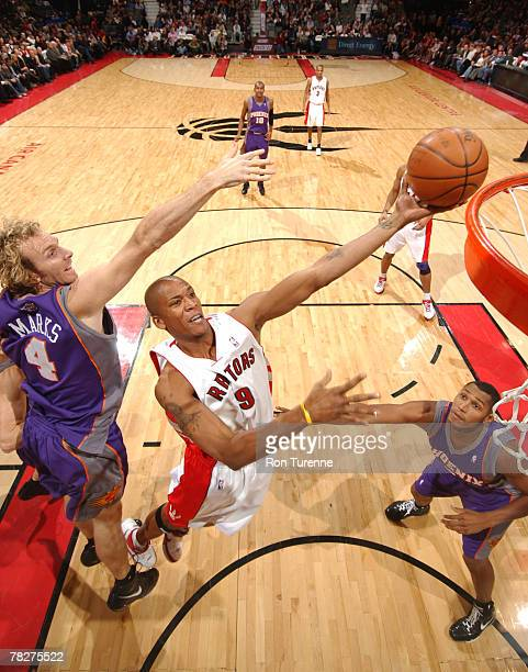 Maceo Baston of the Toronto Raptors drives past Sean Marks of the Phoenix Suns on December 5 2007 at the Air Canada Centre in Toronto Canada NOTE TO...