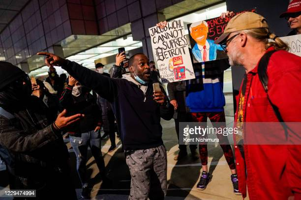 Maceo Rhodes of Detroit, talks with a supporter of Donald Trump at the Detroit Department of Elections Central Counting Board of Voting absentee...