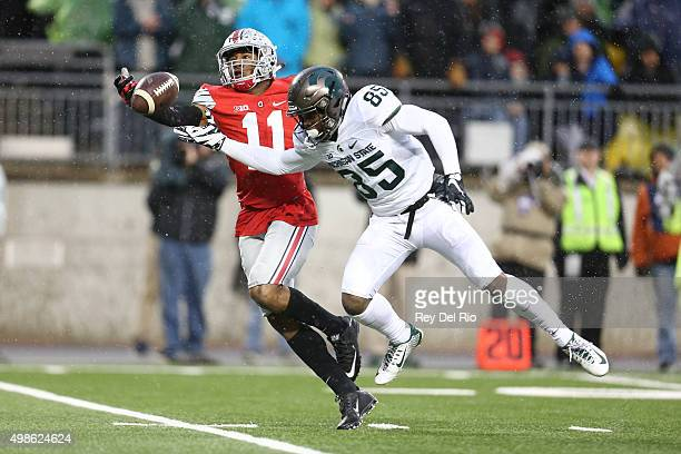 Macgarrett Kings Jr #85 of the Michigan State Spartans attempts to catch the ball against Vonn Bell of the Ohio State Buckeyes at Ohio Stadium on...