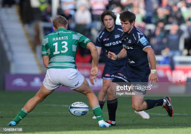 MacGinty of Sale Sharks and Chris Harris of Newcastle Falcons during the Gallagher Premiership Rugby match between Sale Sharks and Newcastle Falcons...