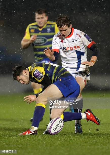 MacGinty of Sale Sharks closes down Tomos Williams of Cardiff Blues during The European Rugby Challenge Cup match on December 9 2017 in Salford...