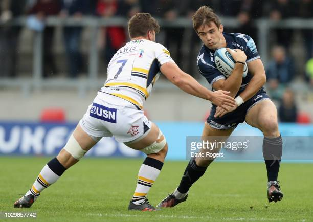 MacGinty of Sale Sharks goes past Sam Lewis during the Gallagher Premiership Rugby match between Sale Sharks and Worcester Warriors at the AJ Bell...
