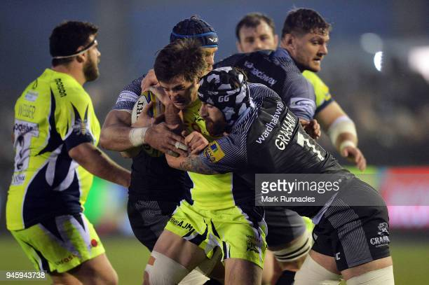 MacGinty of Sale Sharks is tackled by Gary Graham of Newcastle Falcons during the Aviva Premiership match between Newcastle Falcons and Sale Sharks...