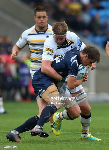 MacGinty of Sale Sharks is tackled by GJ Van Velze of Worcester Warriors during the Gallagher Premiership Rugby match between Sale Sharks and...