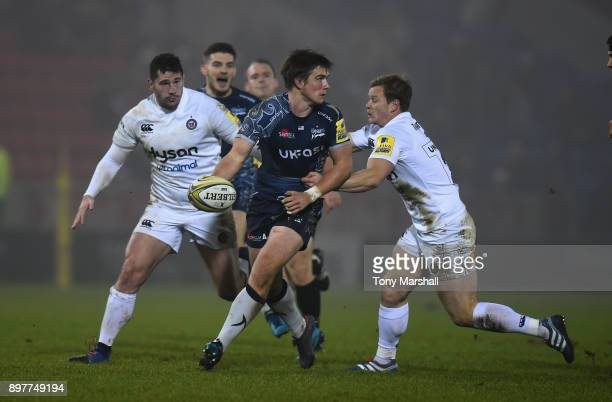 MacGinty of Sale Sharks looks to off load the ball during the Aviva Premiership match between Sale Sharks and Bath Rugby at AJ Bell Stadium on...