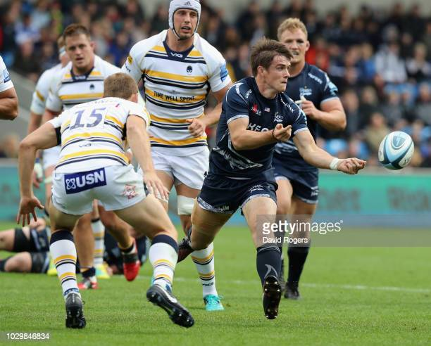 MacGinty of Sale Sharks passes the ball during the Gallagher Premiership Rugby match between Sale Sharks and Worcester Warriors at the AJ Bell...