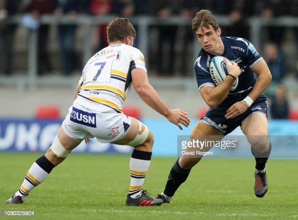MacGinty of Sale Sharks runs with the ball during the Gallagher Premiership Rugby match between Sale Sharks and Worcester Warriors at the AJ Bell...