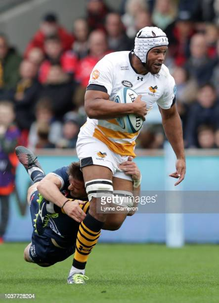 MacGinty of Sale Sharks tackles Nizaam Carr of Wasps during the Gallagher Premiership Rugby match between Sale Sharks and Wasps at AJ Bell Stadium on...