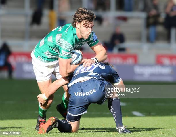 MacGinty of Sale Sharks tackles Rohan J Van Rensburg of Newcastle Falcons during the Gallagher Premiership Rugby match between Sale Sharks and...