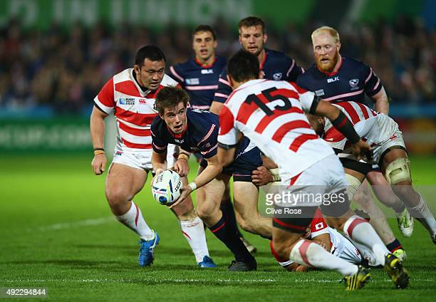 MacGinty of the United States looks to offload during the 2015 Rugby World Cup Pool B match between USA and Japan at Kingsholm Stadium on October 11...