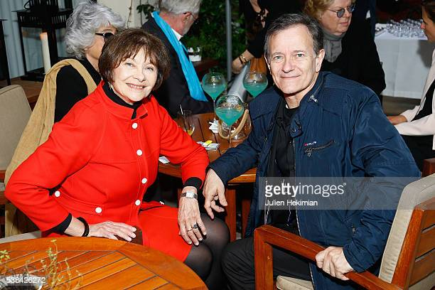Macha Meril and Francis Huster attend the Tribute to Marlene Dietrich Cocktail Party At Hotel Lancaster In Paris on June 6 2016 in Paris France