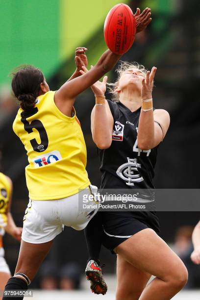 Machaelia Roberts of the Thunder spoils a Danica Pedersen of the Blues mark attempt during the round six VFLW match between Carlton and NT Thunder at...