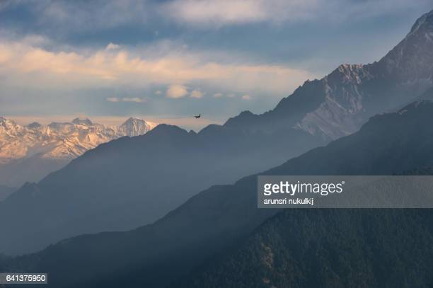 machapuchare annapurna mountain range view from poon hill. - machapuchare stock photos and pictures
