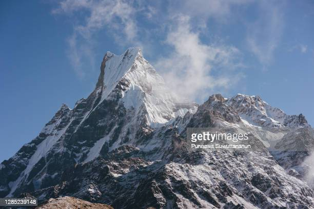 machapuchare mountain peak, sacred peak in annapurna mountain range view from mardi himal trekking route. himalaya mountains range in nepal - pokhara stock pictures, royalty-free photos & images