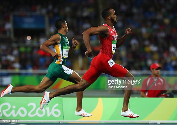 Machel Cedenio of Trinidad and Tobago and Wayde van Niekerk of South Africa compete in the Men's 400m Semi Final on Day 8 of the Rio 2016 Olympic...