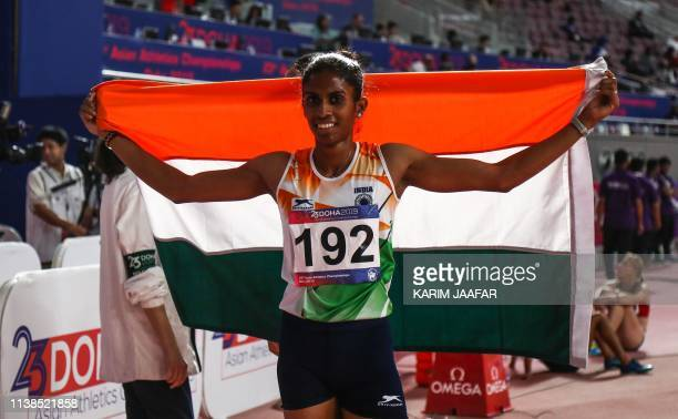 Machettira Raju Poovamma of India celebrates after the second heat first round of the women's 400m race during 23rd Asian Athletics Championships at...