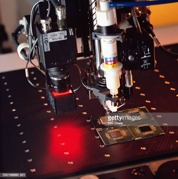 Machine administering resin to chip