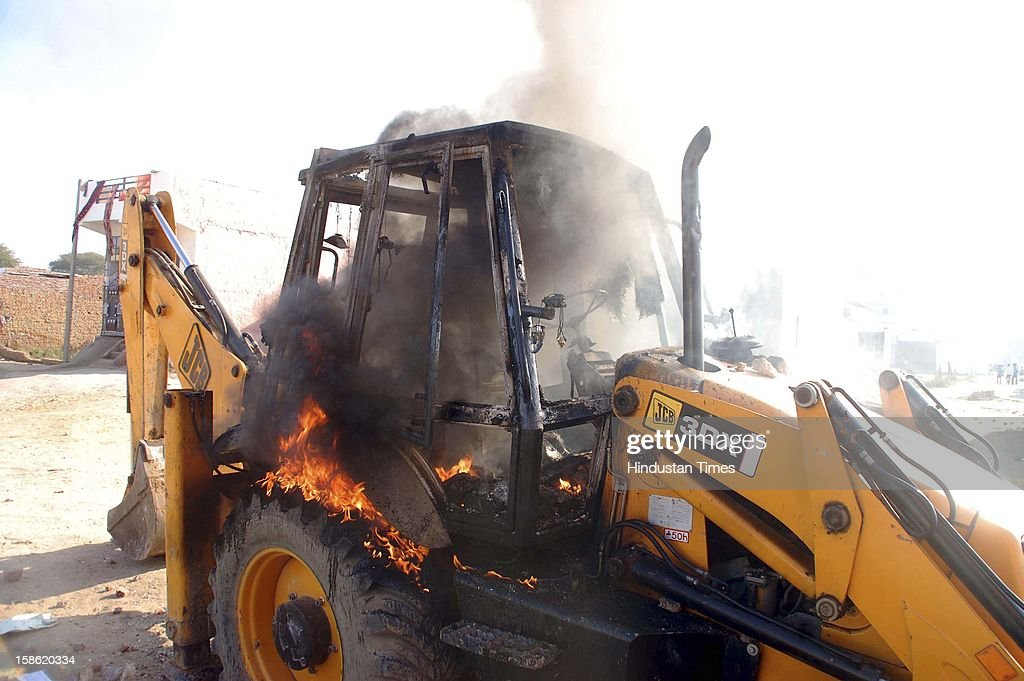 JCB machine burnt during the clash between police and residents of Sheetla colony while demolition of illegal construction by administration on December 21, 2012 in Gurgaon, India. Police has arrested some people in the case.