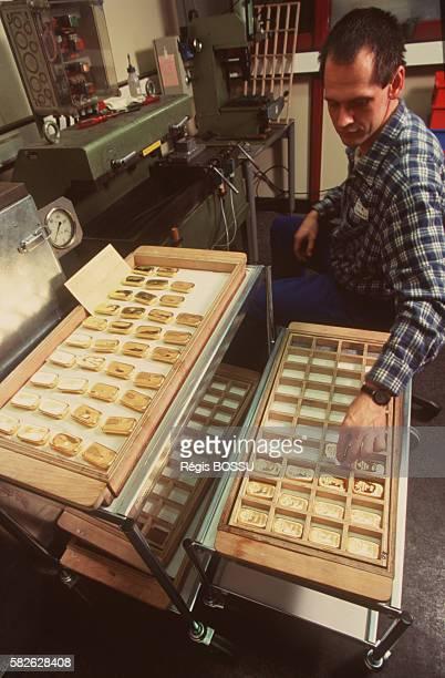 Machine engraving the gold ingots