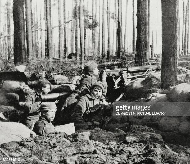 Machine gun in position in a trench France World War I photo by Photo Bureau from L'Illustrazione Italiana Year XLII No 14 April 4 1915