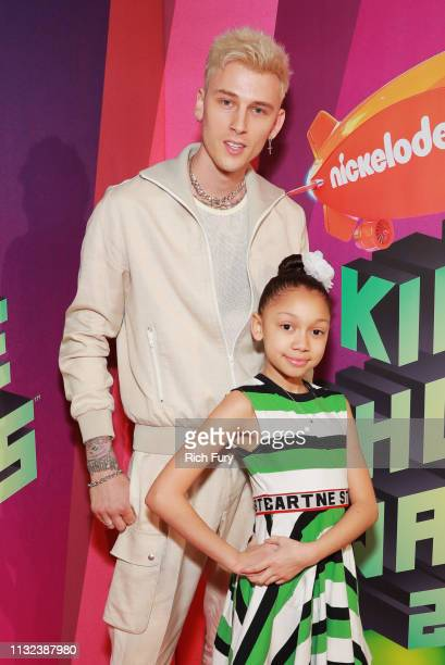 Machine Gun Kelly and Casie Colson Baker attend Nickelodeon's 2019 Kids' Choice Awards at Galen Center on March 23 2019 in Los Angeles California