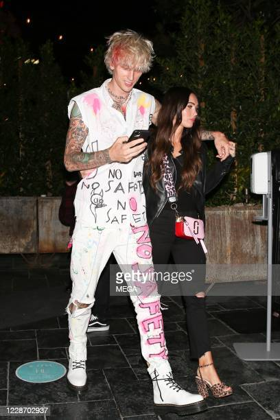 Machine Gun Kelly and Megan Fox are seen leaving a restaurant on September 24, 2020 in Los Angeles, California.