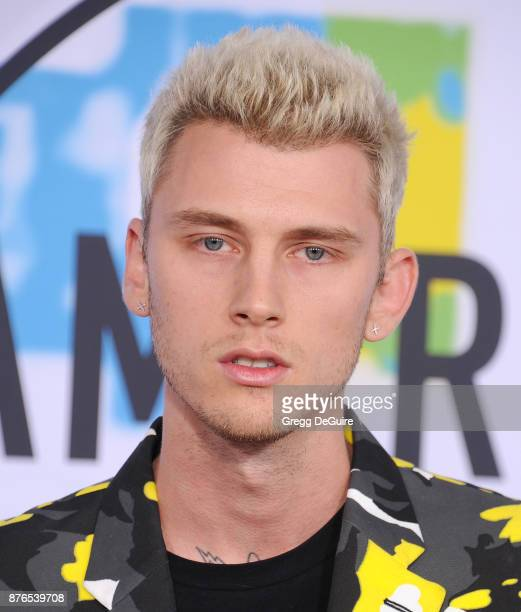 Machine Gun Kelly arrives at the 2017 American Music Awards at Microsoft Theater on November 19 2017 in Los Angeles California