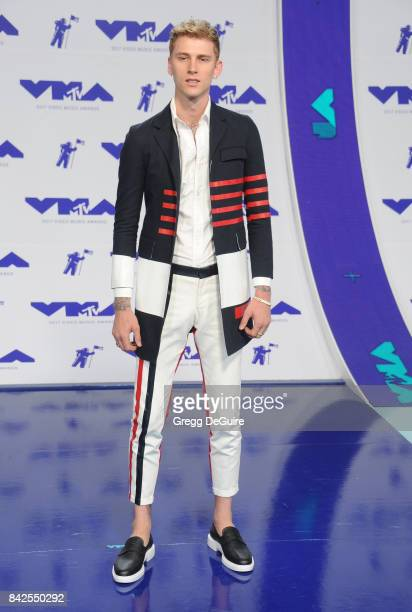 Machine Gun Kelly arrives at the 2017 MTV Video Music Awards at The Forum on August 27 2017 in Inglewood California